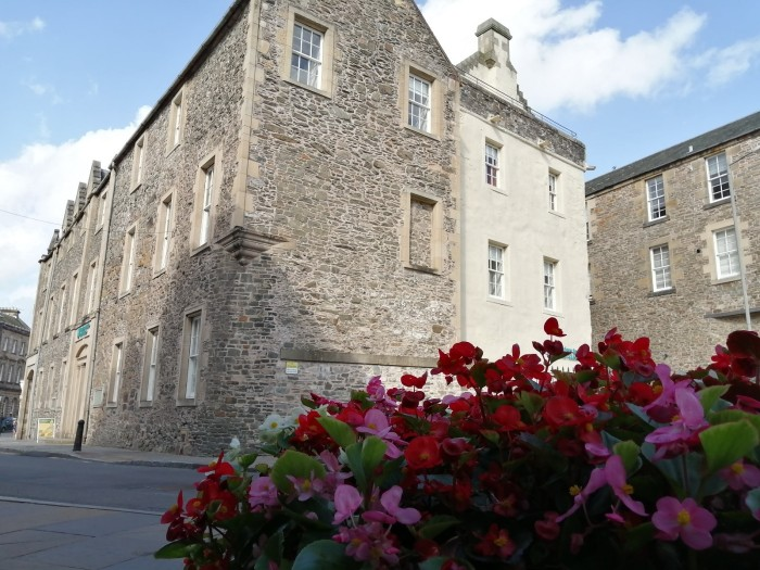 Scottish Borders Flowers Stone building Hawick blue skies