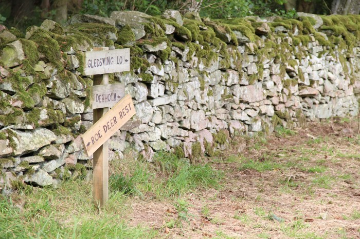 Scottish Borders Wooden sign field stone wall