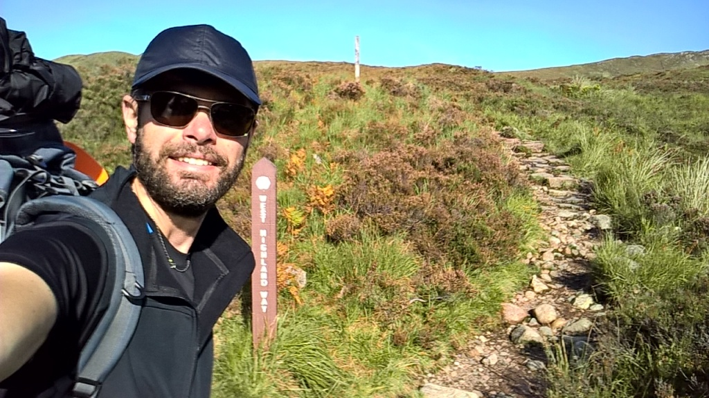 west highland way, scotland, mountains, steps, hills, guy in sunglasses, hiking gear, rucksack