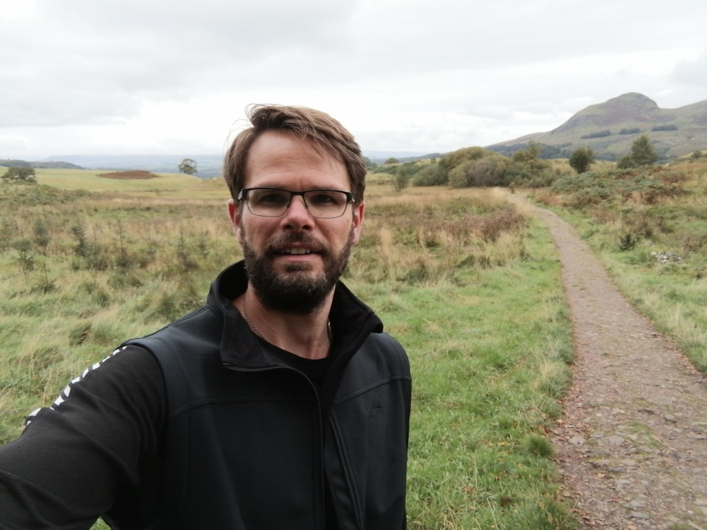 west highland way, scotland, hills, countryside, path, guy smiling,
