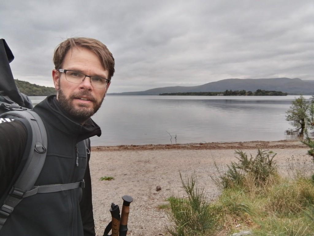 west highland way, scotland, loch lomond, beach, guy walking, hiking gear