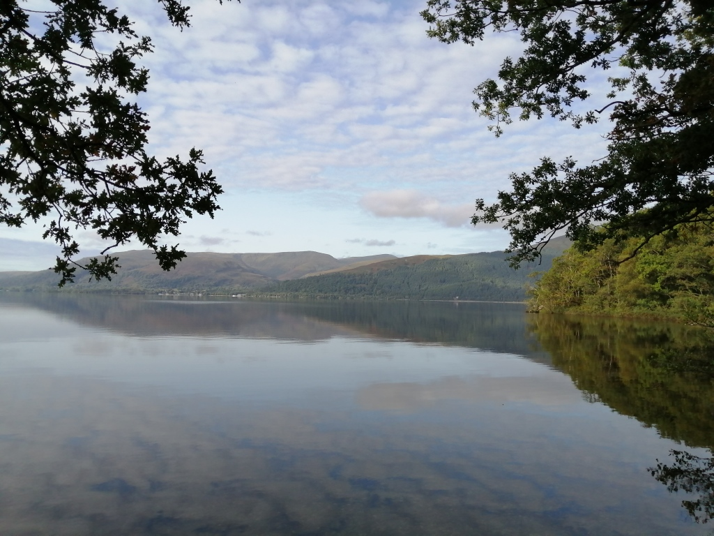 west highland way, scotland, loch lomond, open water, blue skies, reflections, trees