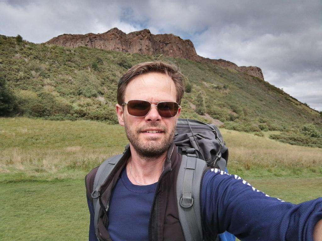 guy in sunglasses, rocky mountain, rucksack, backpack,