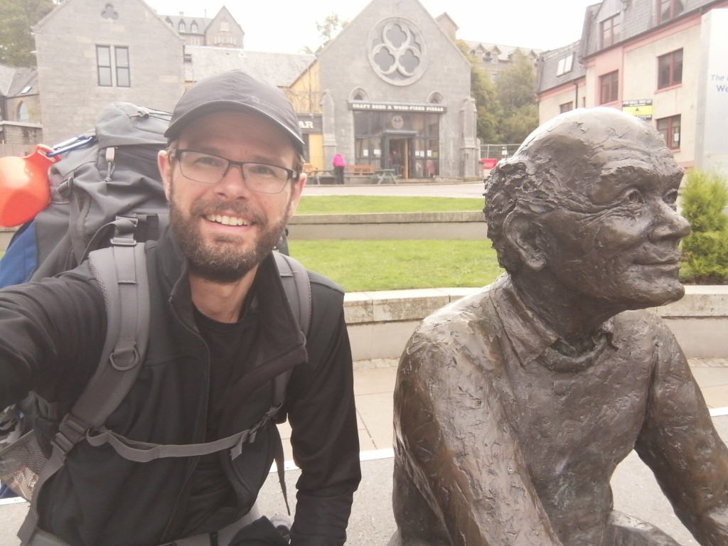 west highland way, scotland, guy in cap, hiking gear, town square