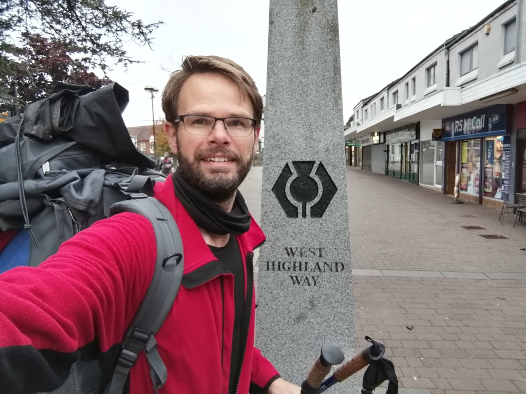 west highland way, milngavie, rucksack, hiking gear, guy smiling, town centre, glasgow, scotland