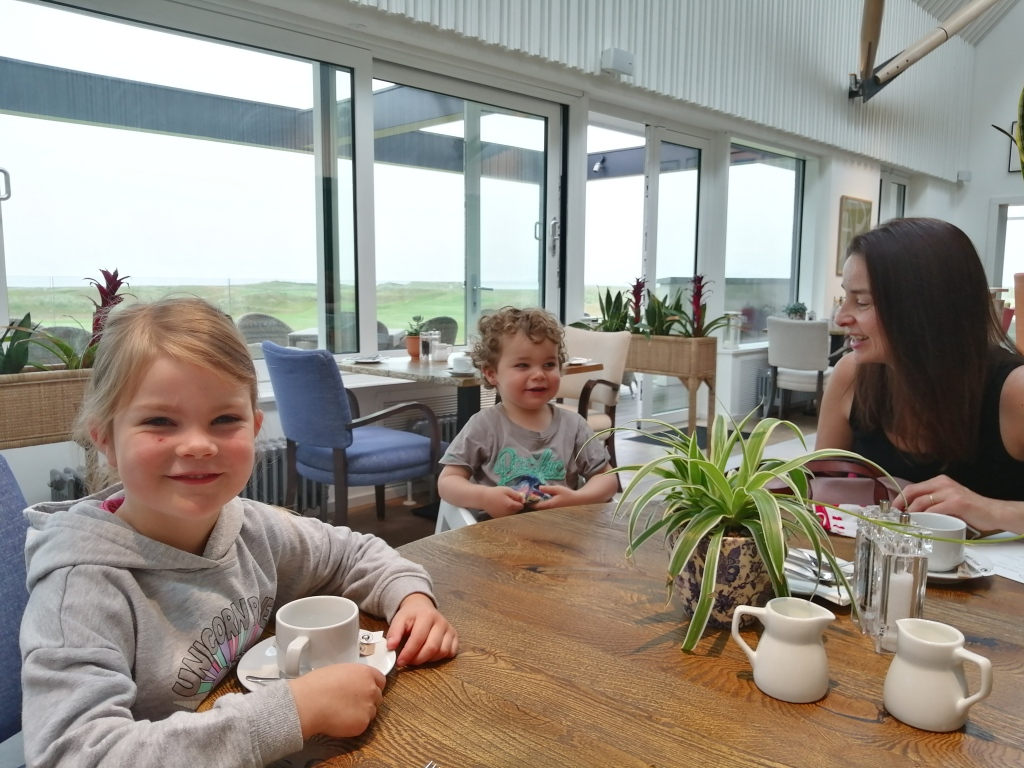 smiling children, restaurant, tables, chairs, cups, machrie hotel, islay, scotland