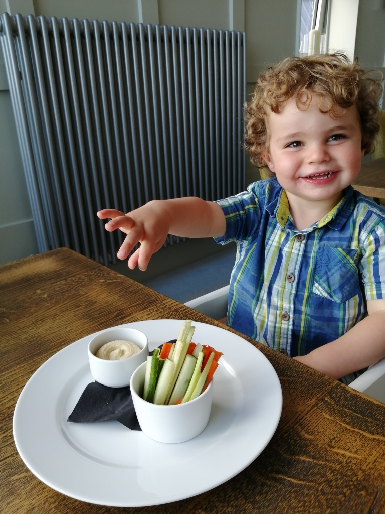 smiling boy, carrots and dips, machrie hotel, islay, scotland