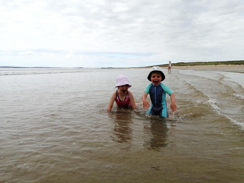 children swimming, children laughing, beach, open water, laggan bay, machrie, islay, scotland