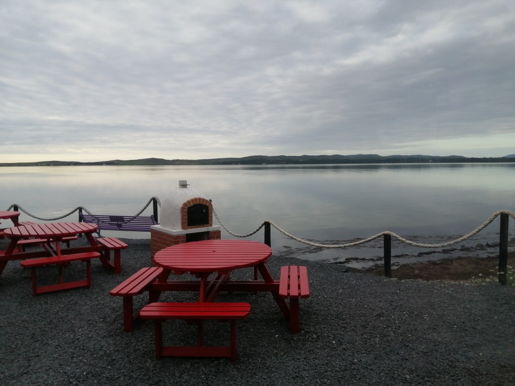 peatzeria, open water, wooden bench, pizza oven, bowmore, islay, scotland