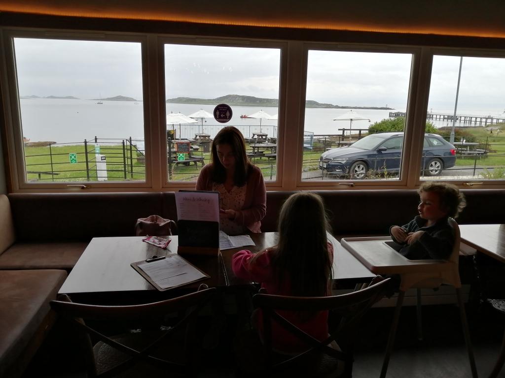 jura hotel, restaurant, lady reading, children, car, open water, tables, jura,scotland
