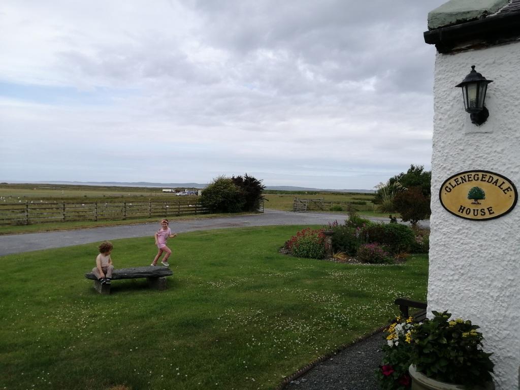 children playing, glenegdale house, flowers, islay, scotland