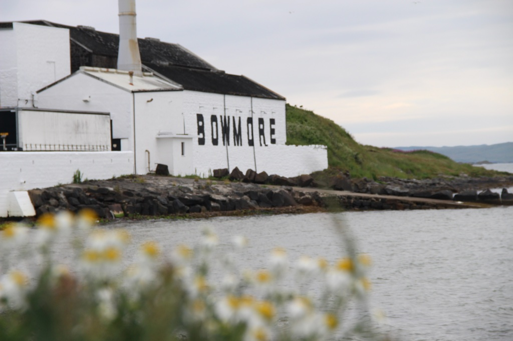 whisky distillery, bowmore, flowers, white building, islay, scotland
