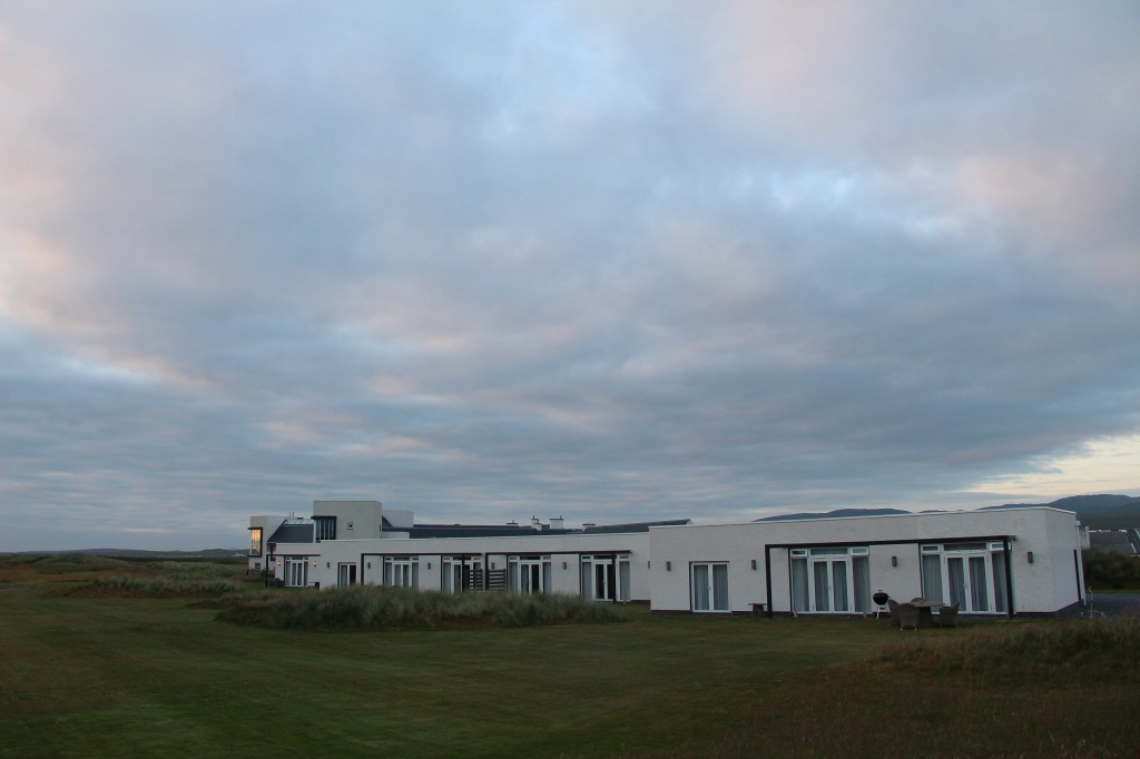 Machrie Hotel Lodges, white building, sunset, colourful clouds, islay, scotland