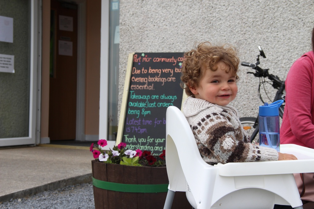 smiling boy, happy boy, restaurant sign, flowers, islay, scotland