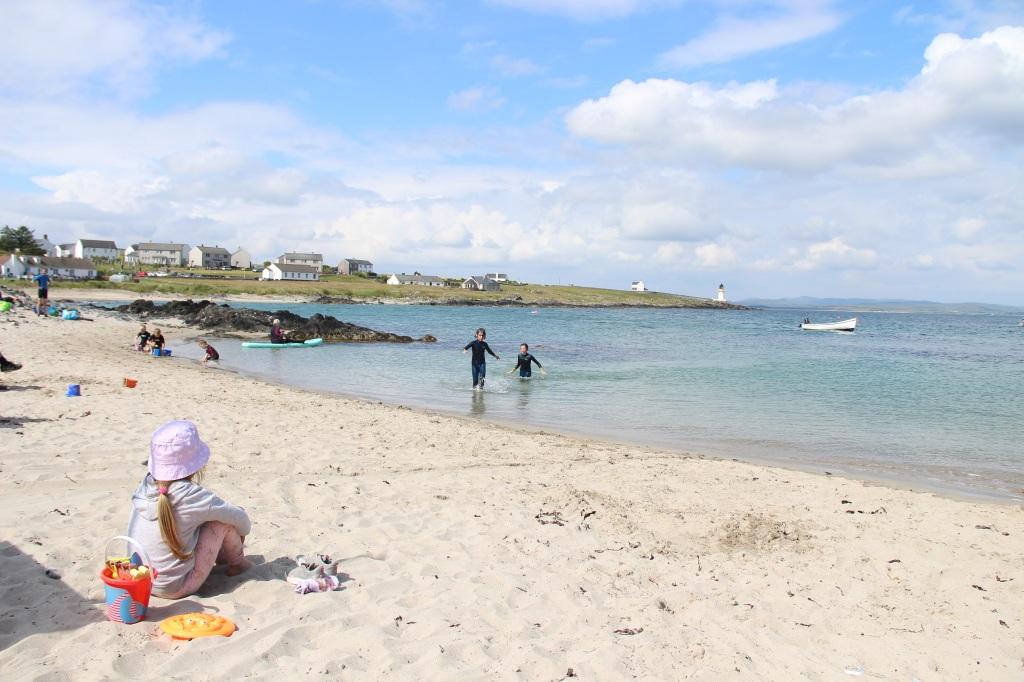 blue skies, white clouds, turquoise water, children playing, white sand, port ellen, islay, scotland