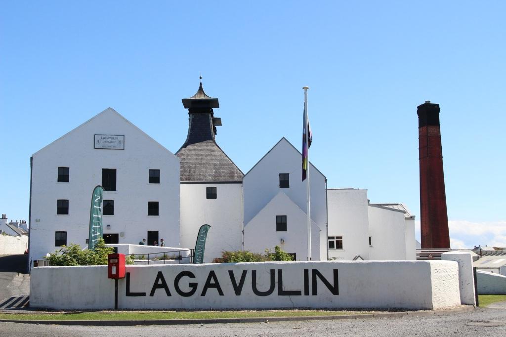 lagavulin distillery, lagavulin, whisky, distillery, blue skies, white building, islay, scotland
