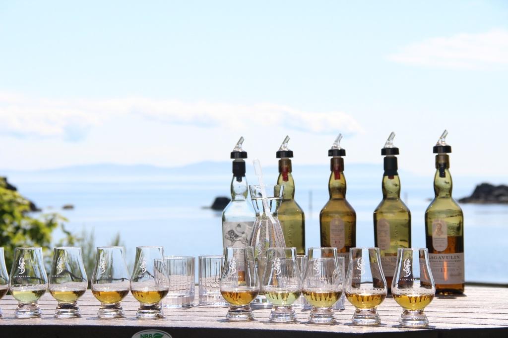 whisky bottles, whisky glass, lagavulin whisky, whisky, whisky tasting, blue skies, islay, scotland
