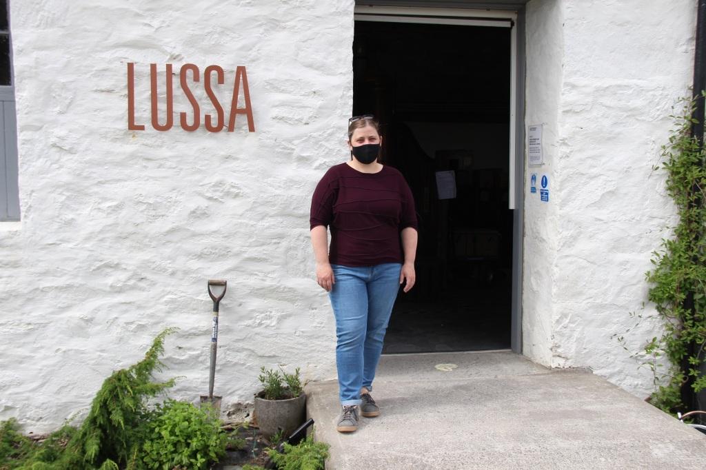 lussa sign, lady in mask, lussa gin, jura, scotland