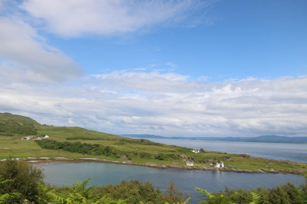 open water, blue skies, white houses, jura, scotland