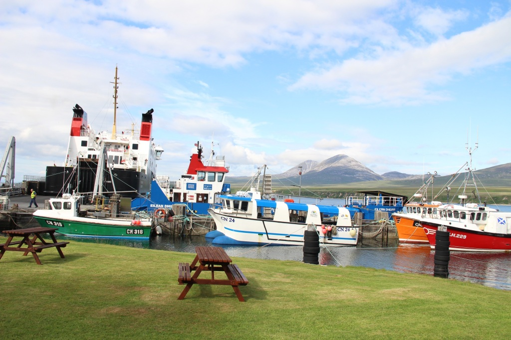 port askaig, boats, ferry, hills, blue skies, wooden bench, jura, islay, scotland