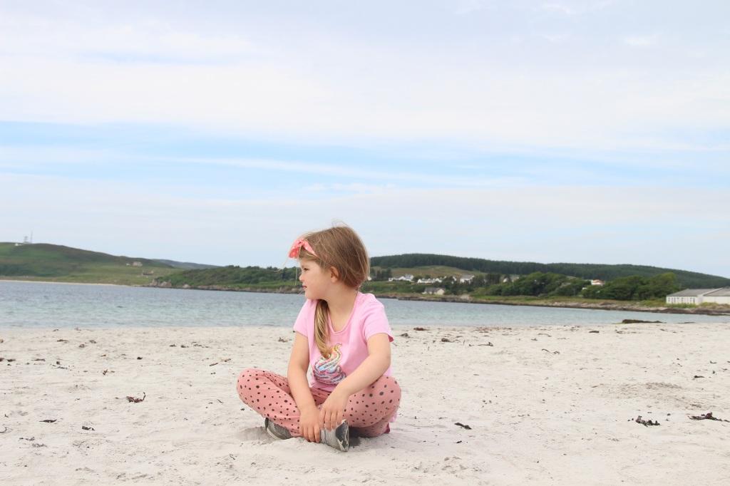 girl on beach, white sand, port ellen, islay, scotland