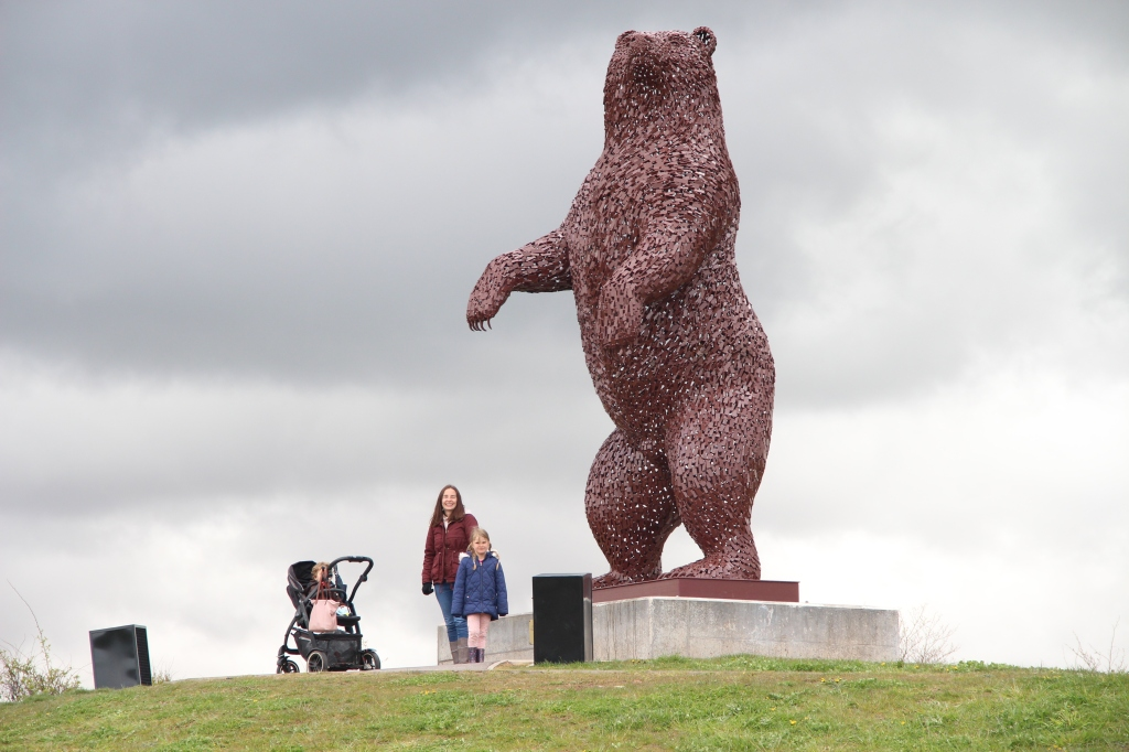 artwork by andy scott, dunbear by dunbar, large bear sculpture, lady and girl with pram